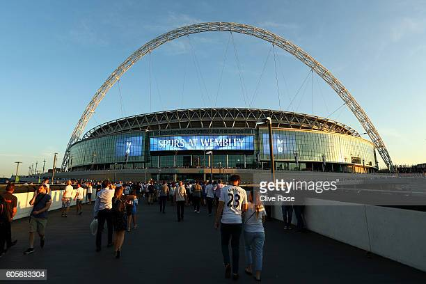 Fans arrive at the stadium prior to the UEFA Champions League match between Tottenham Hotspur FC and AS Monaco FC at Wembley Stadium on September 14...