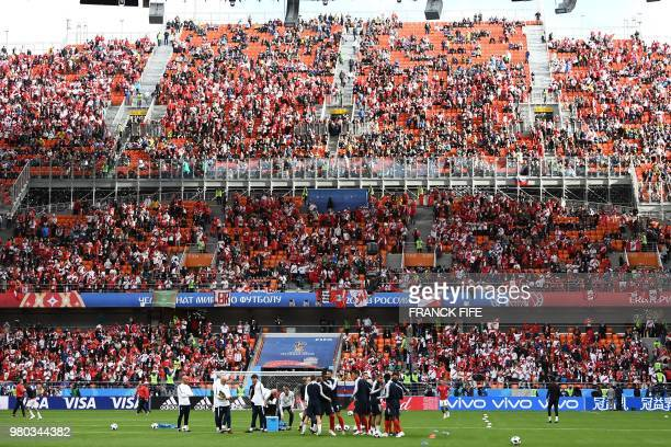 Fans arrive at the stadium while France's team players warm up prior to the Russia 2018 World Cup Group C football match between France and Peru at...