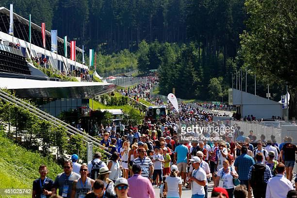 Fans arrive at the track ahead of the Austrian Formula One Grand Prix at Red Bull Ring on June 22 2014 in Spielberg Austria