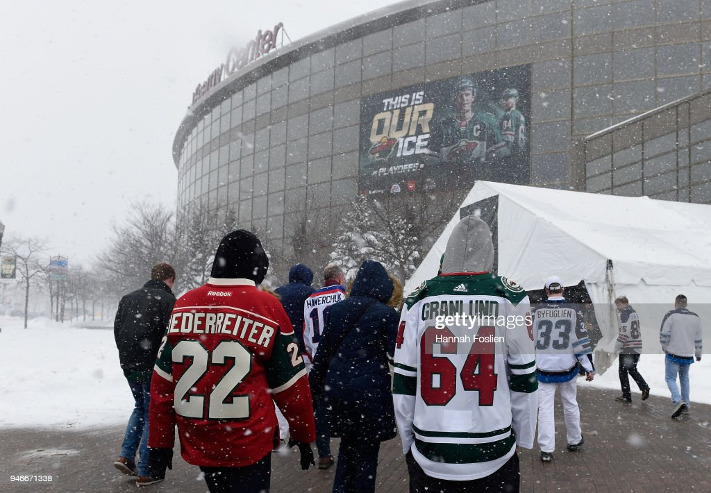 Fans arrive at Xcel Energy Center before Game Three of the Western Conference First Round between the Minnesota Wild and the Winnipeg Jets during the 2018 NHL Stanley Cup Playoffs on April 15, 2018 in St Paul, Minnesota.