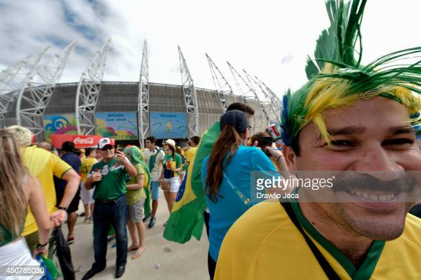 Fans arrive before the start of the 2014 FIFA World Cup match between Mexico and Brazil at Castelao Stadium on June 17 2014 in Fortaleza Brazil