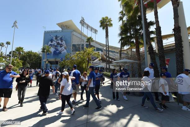 Fans arrive for a baseball game between San Francisco Giants and Los Angeles Dodgers on Opening Day at Dodger Stadium on March 29 2018 in Los Angeles...