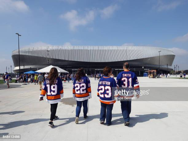 Fans arrive for a preseason game between the New York Islanders and the Philadelphia Flyers at the Nassau Veterans Memorial Coliseum on September 17,...