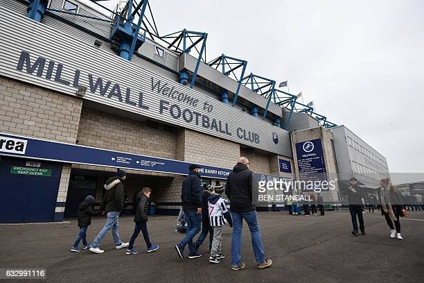 Fans arrive for the English FA Cup fourth round football match between Millwall and Watford at The Den in south London on January 29 2017 / AFP / Ben...