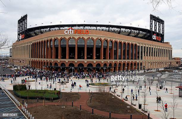 Fans arrive for the exhibition game between the New York Mets and the Boston Red Sox on April 4 2009 at Citi Field in the Flushing neighborhood of...