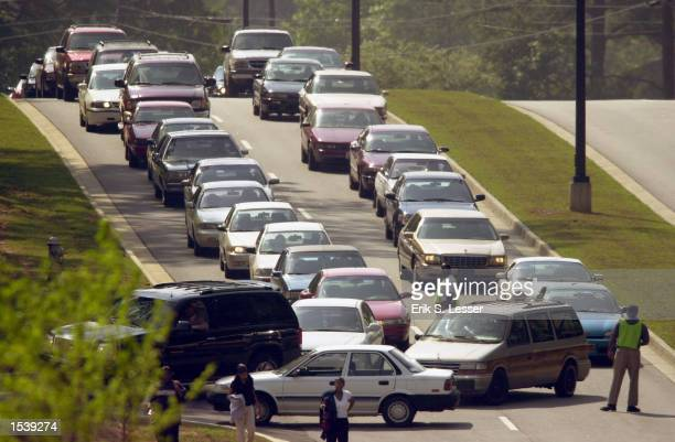 Fans arrive for the public funeral of singer Lisa Left Eye Lopes at the New Birth Missionary Baptist Church May 2 2002 in Lithonia GA Lopes was...