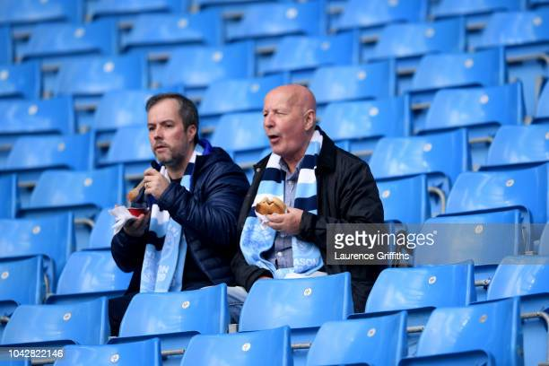 Fans arrive inside the stadium ahead of the Premier League match between Manchester City and Brighton Hove Albion at Etihad Stadium on September 29...