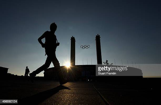 Fans arrive outside the Olympic stadium prior to the Bundesliga match between Hertha BSC and Vfb Stuttgart at Olympiastadion on October 3, 2014 in...