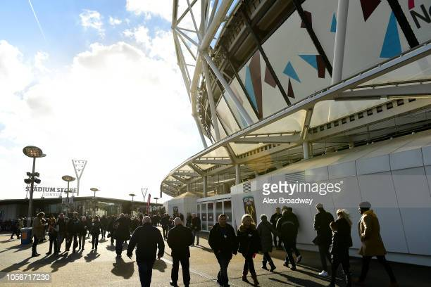 Fans arrive outside the stadium ahead of the Premier League match between West Ham United and Burnley FC at London Stadium on November 3 2018 in...