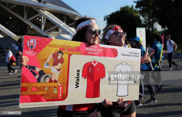 Fans arrive outside the stadium ahead of the Rugby World Cup 2019 Group D game between Wales and Fiji at Oita Stadium on October 09 2019 in Oita Japan