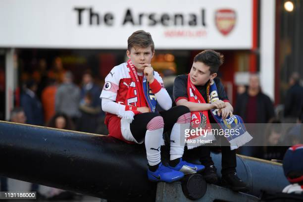 Fans arrive outside the stadium ahead of the UEFA Europa League Round of 32 Second Leg match between Arsenal and BATE Borisov at Emirates Stadium on...