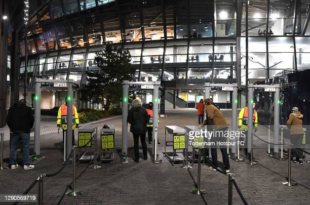 Fans arrive outside the stadium and enter through the security ahead of the UEFA Europa League Group J stage match between Tottenham Hotspur and...