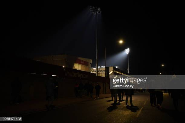 Fans arrive outside the stadium prior to during the Premier League match between Burnley FC and Newcastle United at Turf Moor on November 26 2018 in...