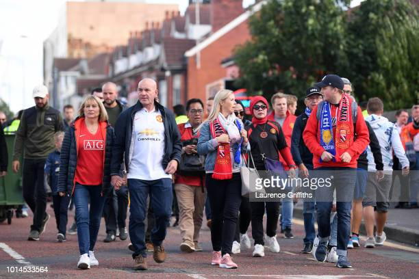 Fans arrive outside the stadium prior to the Premier League match between Manchester United and Leicester City at Old Trafford on August 10 2018 in...