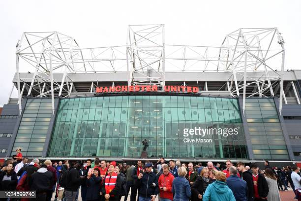 Fans arrive outside the stadium prior to the Premier League match between Manchester United and Tottenham Hotspur at Old Trafford on August 27 2018...