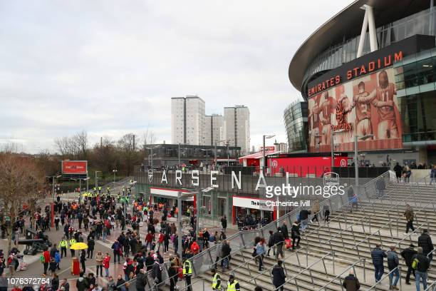 Fans arrive outside the stadium prior to the Premier League match between Arsenal FC and Fulham FC at Emirates Stadium on January 1 2019 in London...