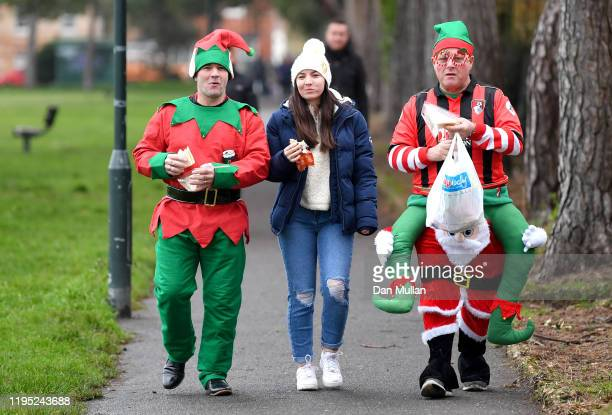 Fans arrive outside the stadium prior to the Premier League match between AFC Bournemouth and Burnley FC at Vitality Stadium on December 21 2019 in...