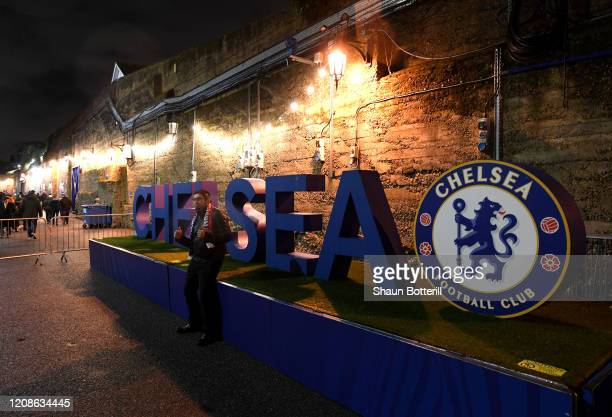 Fans arrive outside the stadium prior to the UEFA Champions League round of 16 first leg match between Chelsea FC and FC Bayern Muenchen at Stamford...
