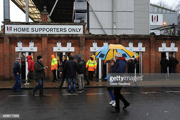 Fans arrive prior to kickoff during the Barclays Premier League match between Fulham and West Ham United at Craven Cottage on January 1 2014 in...