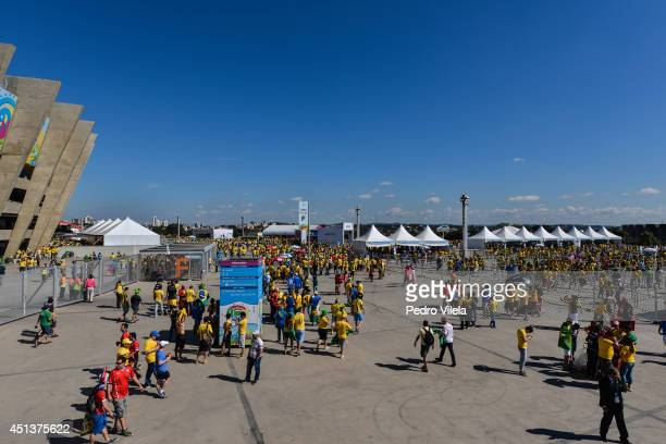 Fans arrive prior to kickoff to the 2014 FIFA World Cup Brazil round of 16 match between Brazil and Chile at Estadio Mineirao on June 28 2014 in Belo...