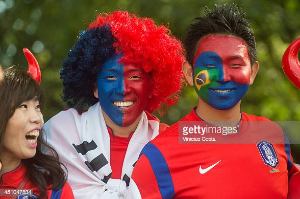 Fans arrive prior to the 2014 FIFA World Cup Brazil Group H match between Korea Republic and Algeria at Beira Rio Stadium on June 22 2014 in Porto...