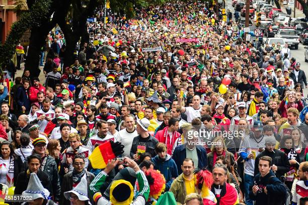 Fans arrive prior to the 2014 FIFA World Cup Brazil Round of 16 match between Germany and Algeria at Beira Rio Stadium on June 30, 2014 in Porto...