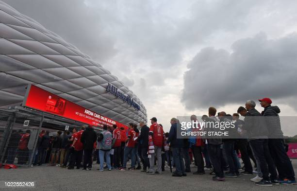 Fans arrive prior to the German first division Bundesliga football match FC Bayern Munich v TSG 1899 Hoffenheim at the Allianz Arena in Munich...