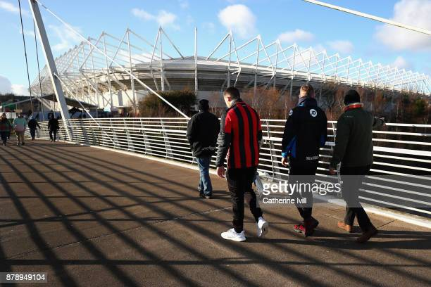 Fans arrive prior to the Premier League match between Swansea City and AFC Bournemouth at Liberty Stadium on November 25 2017 in Swansea Wales