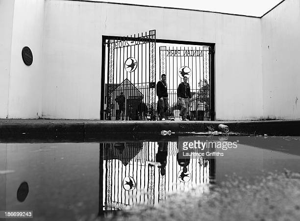 Fans arrive through the old Ninian park gates prior to the Barclays Premier League match between Cardiff City and Swansea at Cardiff City Stadium on...