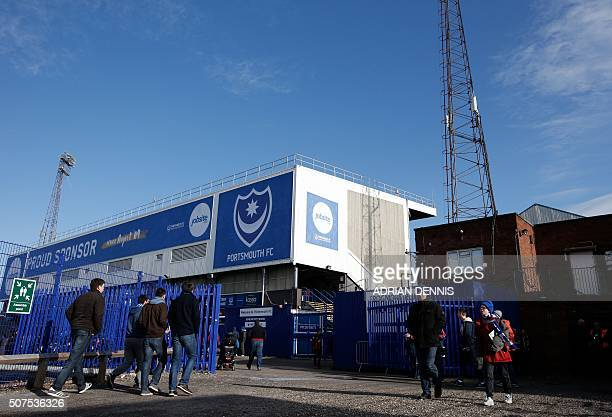 Fans arrive to attend the English FA Cup fourth round football match between Portsmouth and Bournemouth at Fratton Park stadium in Portsmouth...