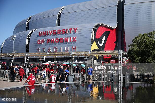 Fans arrive to the NFL game between the Arizona Cardinals and the New England Patriots at the University of Phoenix Stadium on September 11, 2016 in...