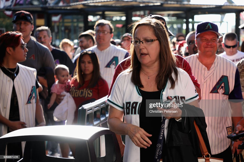 Fans arrive to the openning day MLB game between the Arizona Diamondbacks and the Colorado Rockies at Chase Field on March 29, 2018 in Phoenix, Arizona.