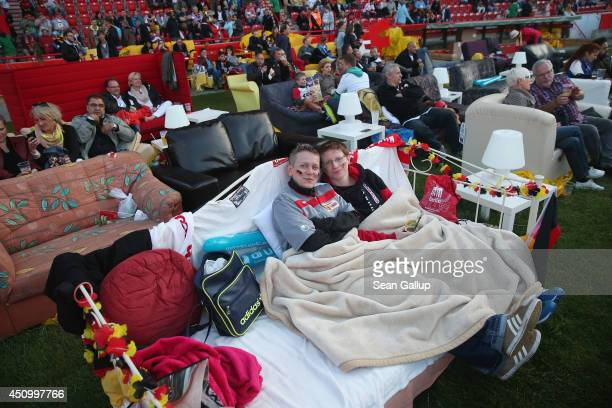 Fans arrive to watch the GermanyGhana World Cup match at a public viewing at the Alte Foersterei FC Union stadium on June 21 2014 in Berlin Germany...