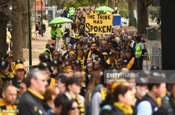 Fans arrive to watch the Tigers players celebrate winning yesterday's AFL Grand Final at Punt Road Oval on October 1 2017 in Melbourne Australia