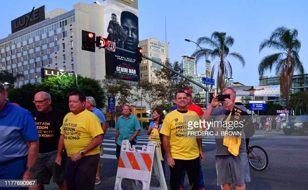NBA fans arrive wearing their free tshirts supporting Hong Kong outside the Staples Center ahead of the Lakers vs Clippers NBA season opener in Los...