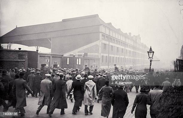 Fans arriving at Arsenal's Highbury stadium to see their team play Aston Villa in the league 17th November 1934