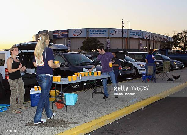 Fans assemble for a game of beer pong prior to the season opener between the Florida Panthers and the New York Islanders at the Nassau Veterans...