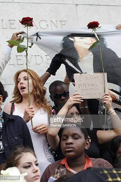Fans at a gathering in memory of Michael Jackson near Notre Dame Church in Paris France on June 26th 2009 Michael Jackson fans