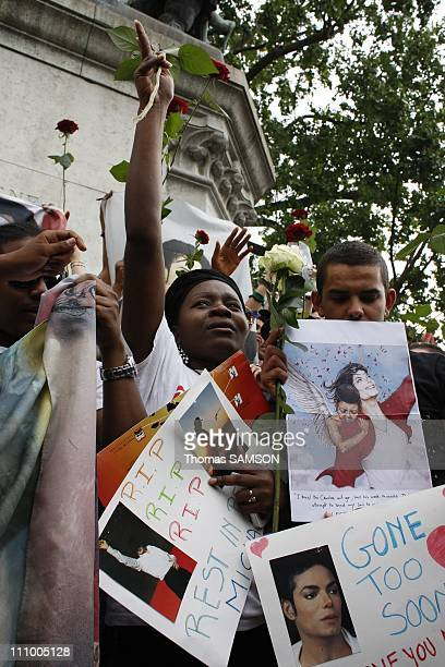 Fans at a gathering in memory of Michael Jackson, near Notre Dame Church in Paris, France on June 26th, 2009 - Michael Jackson fans.