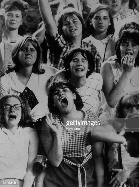 Fans at a performance by the Beatles at Shea Stadium, New York City, 15th August 1965.