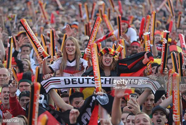 Fans at a public viewing in front of the Brandenburg Gate celebrate prior to the Germany vs Italy quarterfinals 2016 UEFA European Championship match...