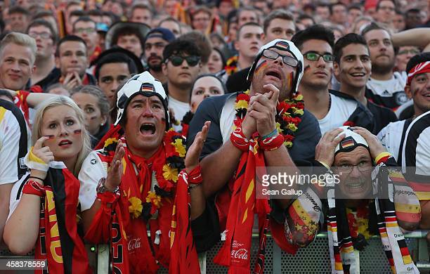 Fans at a public viewing in front of the Brandenburg Gate watch the Germany vs Italy quarterfinals 2016 UEFA European Championship match on July 2...