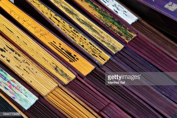 fans at a stand, longhua temple, shanghia, china - longhua temple stock photos and pictures