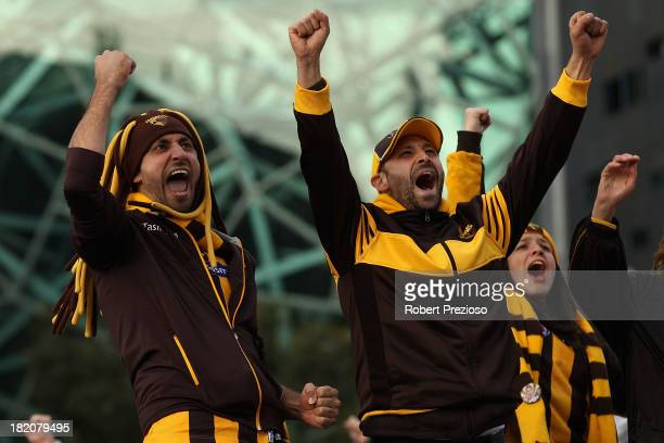 Fans at Federation Square watch the 2013 AFL Grand Final match between the Hawthorn Hawks and the Fremantle Dockers on September 28 2013 in Melbourne...