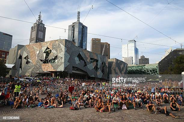 Fans at Federation Square watch the 2015 AFL Grand Final on October 3 2015 in Melbourne Australia