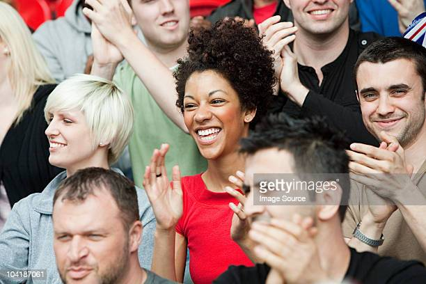 fans at football match - cheering stock photos and pictures
