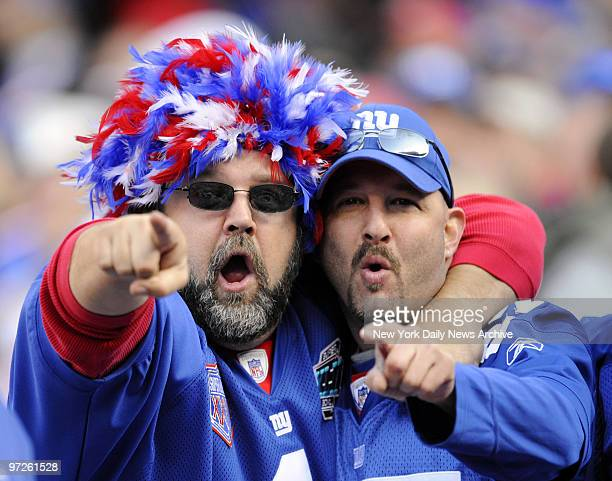 Fans at Giants Stadium see their team defeat Atlanta Falcons 3431 yesterday in overtime to break 4game losing streak