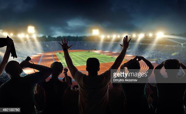 Fans at . stadium with running tracks