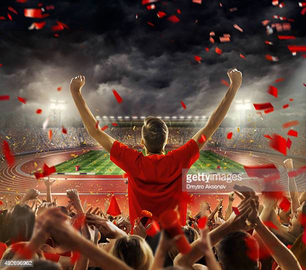 fans at . stadium with running tracks - football fan stock photos and pictures
