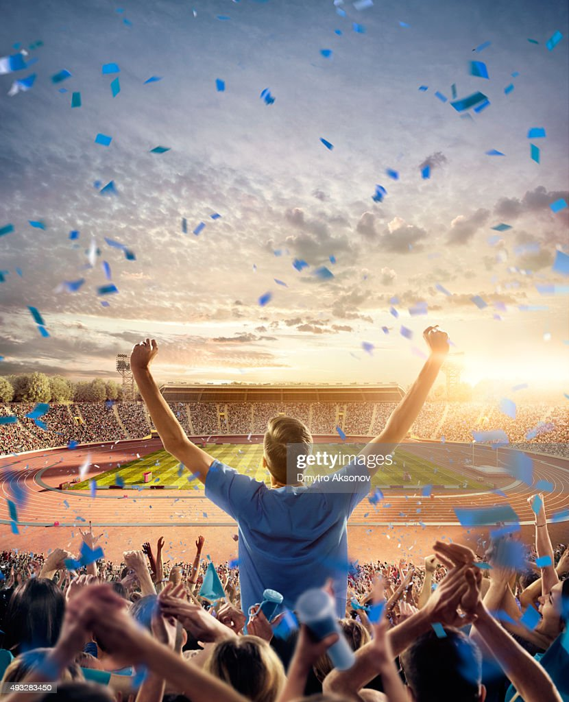 Fans at . stadium with running tracks : Stock Photo